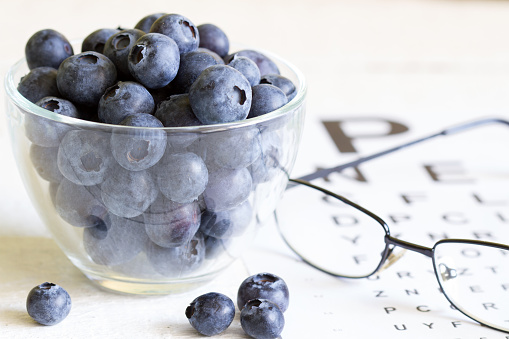 Bilberry Cure For Eyes Concept With Glasses Stock Photo - Download Image Now
