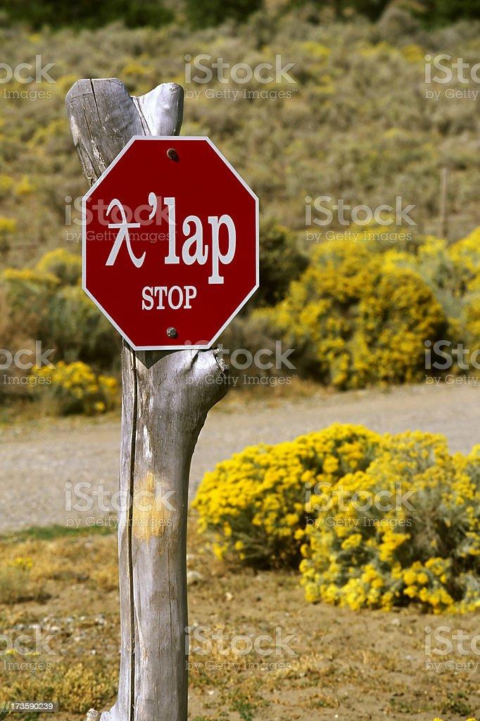 bilingual stop sign osoyoos royalty-free stock photo