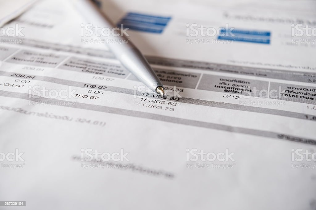 Bill and pen on table stock photo