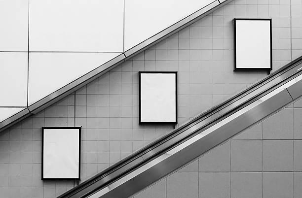 bill board ads at escalator stock photo