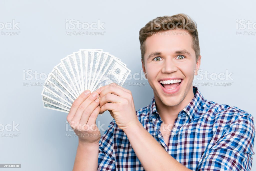 Bill casual career  income earn face emotion expressing happiness people person concept. Close up portrait of man excited cheerful rejoicing delightful guy demonstrating cash isolated gray background royalty-free stock photo