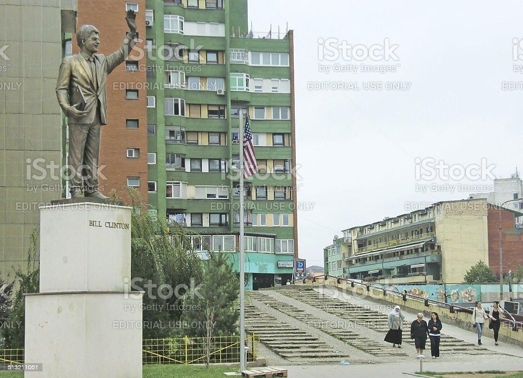Bill Clinton statue and U.S. flag in Pristina, Kosovo stock photo