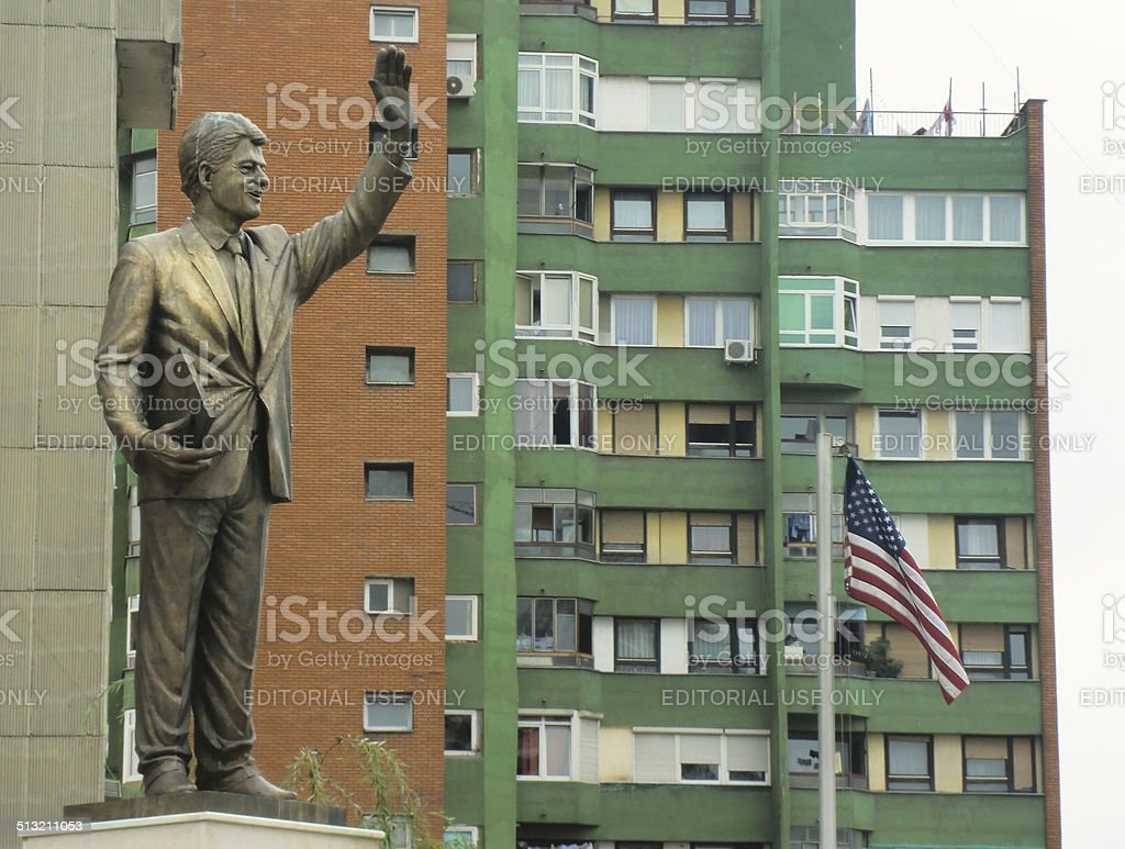 Bill Clinton statue and U.S. flag in Pristina, Kosovo stock photo