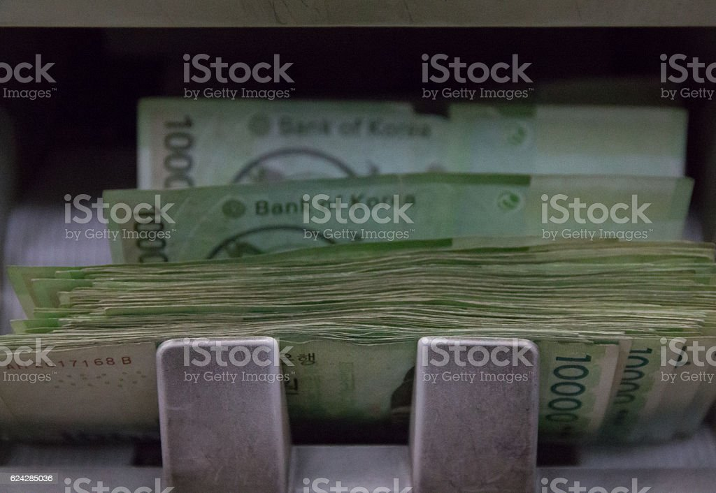 bill counting machines with korea won stock photo