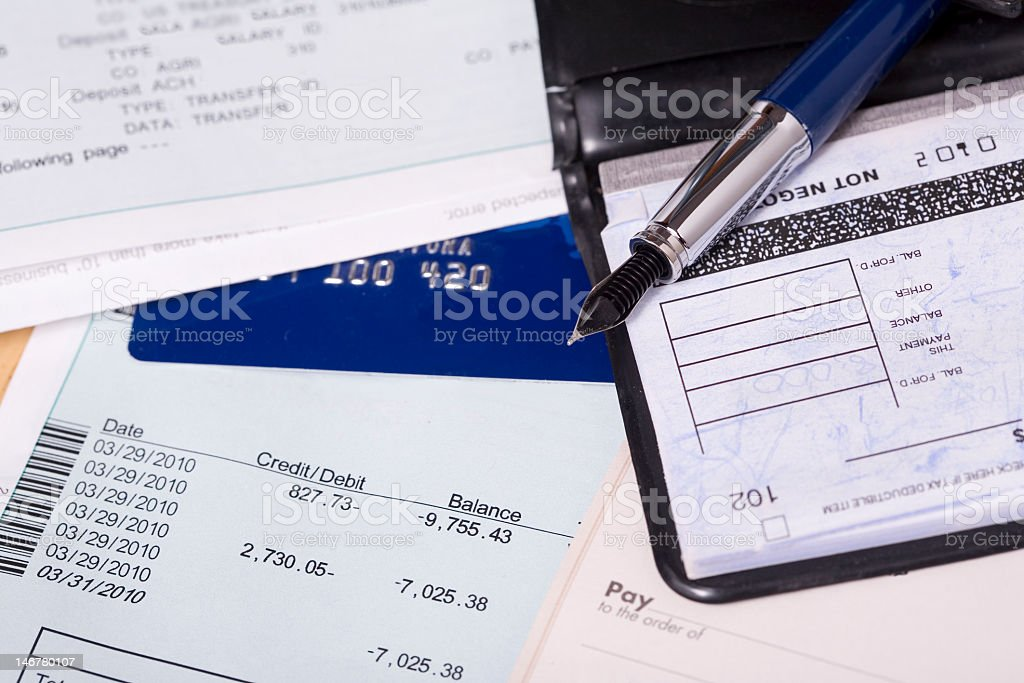 Bill, credit card and a checkbook stock photo