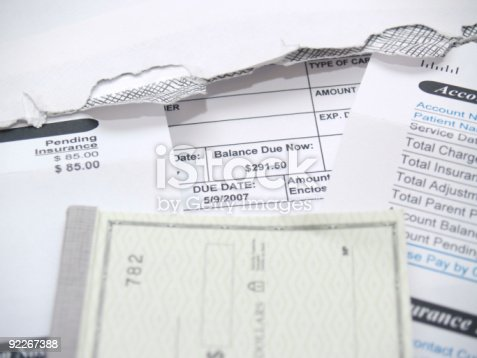 a bill/payment statement with a check book