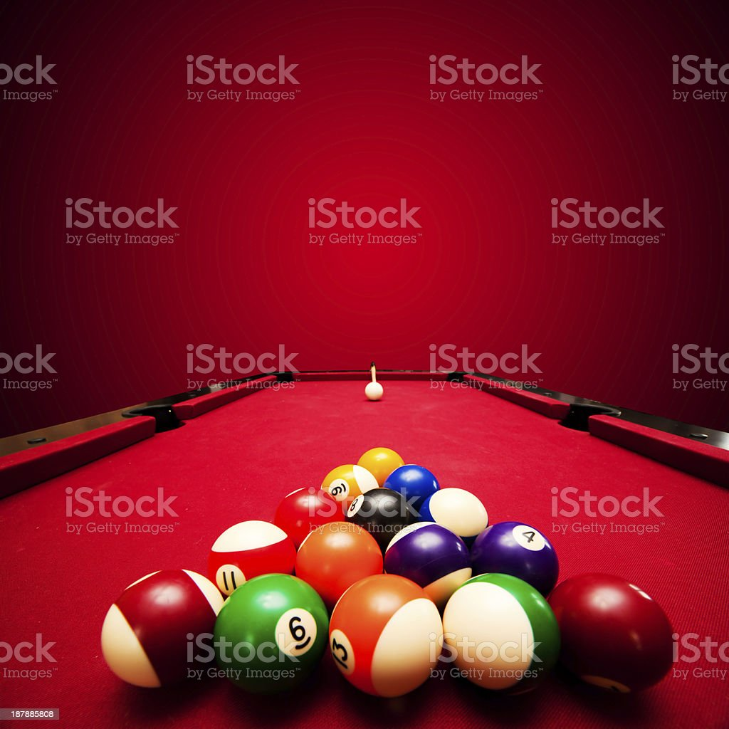 Billards game. Color balls in triangle, aiming at cue ball stock photo