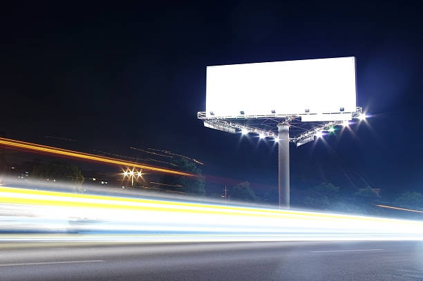 Billboard at night Cars and billboards electronic billboard stock pictures, royalty-free photos & images