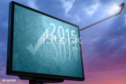 istock Billboard at sunset with a text message for 2015 491961925
