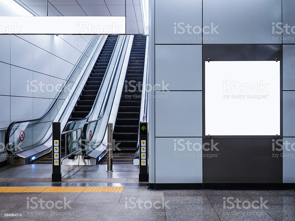 Billboard Banner mock up Media display with escalator in subway stock photo