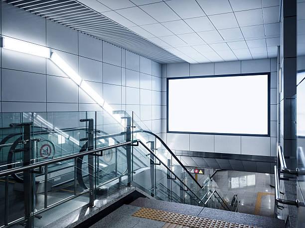 billboard banner signage mock up display in subway with escalator - u bahnstation stock-fotos und bilder