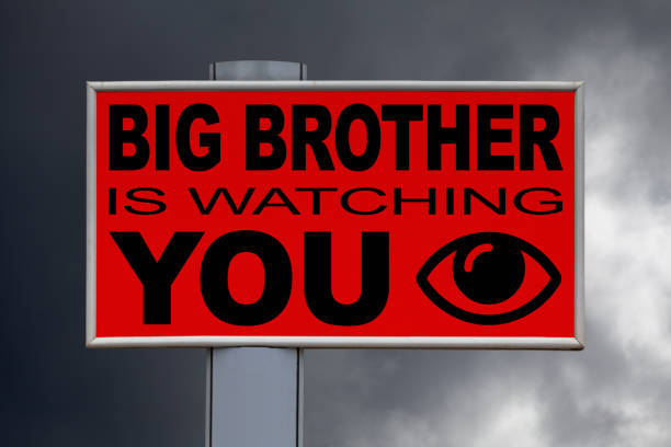 billboard - big brother is watching you - big brother orwellian concept stock pictures, royalty-free photos & images