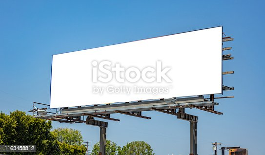 Billboard blank white color, for advertisement on a highway, spring sunny day, blue sky background, copy space