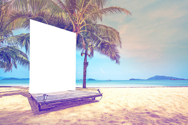 billboard blank on the beach with coconut or palm tree stock photo