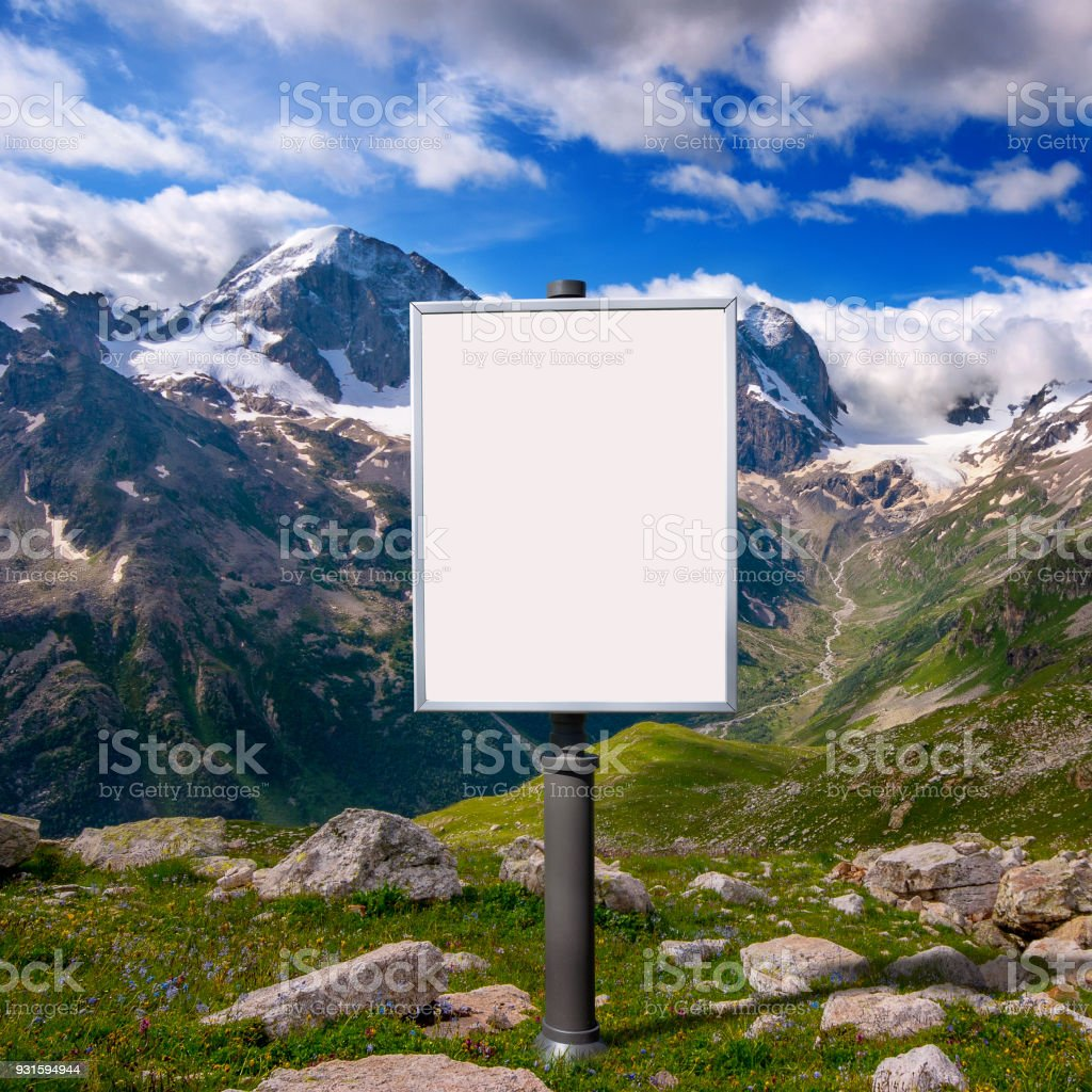 billboard for advertising mounted on a meadow among the mountai stock photo