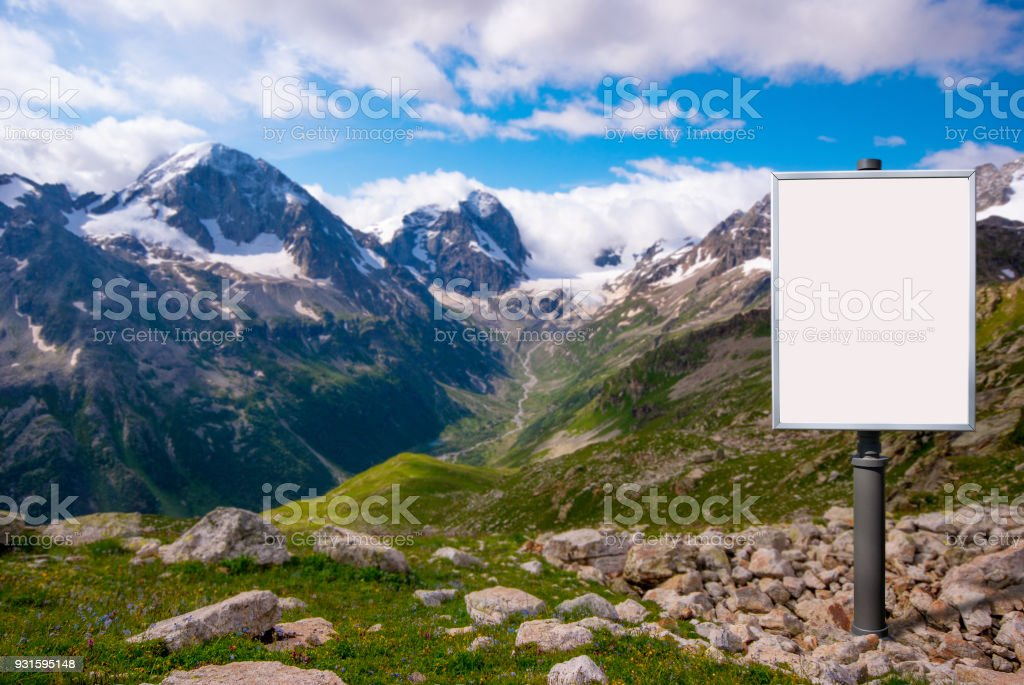 billboard for advertising mounted on a meadow among the mountain stock photo