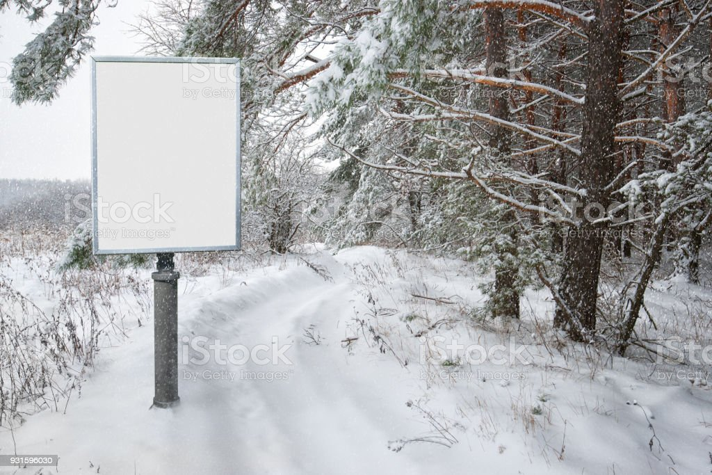billboard for advertising on background snowy forest landscape stock photo