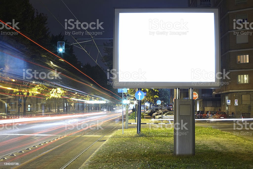 Billboard in the street at night stock photo