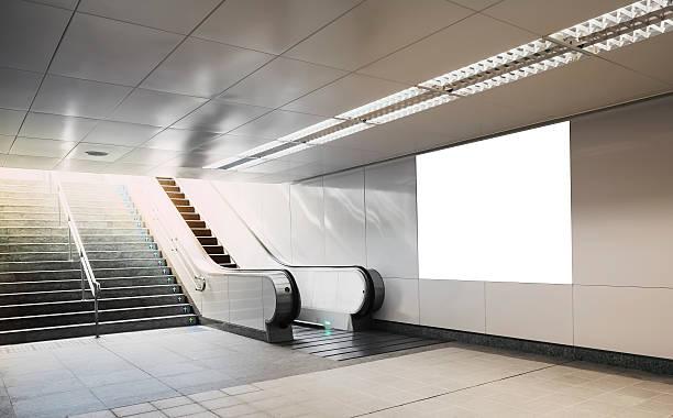 Billboard mock up in subway with escalator stock photo