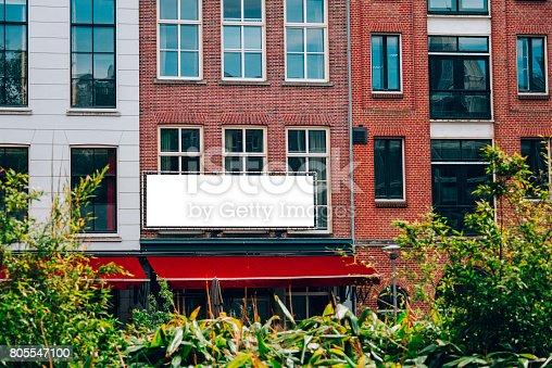 158172107 istock photo Billboard on building facade 805547100