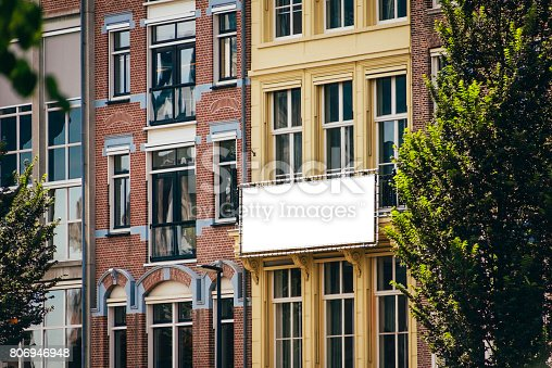 158172107 istock photo Billboard on building facade 806946948