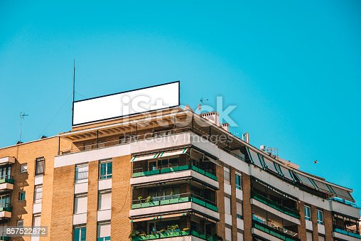 158172107 istock photo Billboard on top of building 857522672