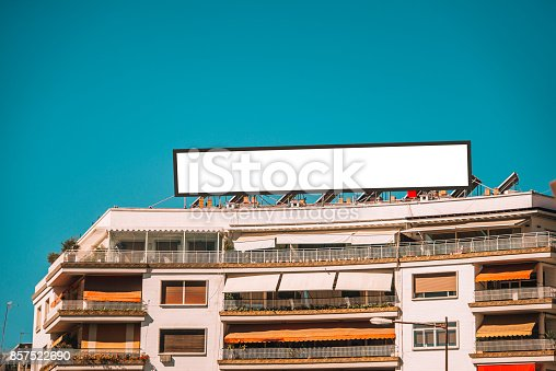 158172107 istock photo Billboard on top of building 857522690