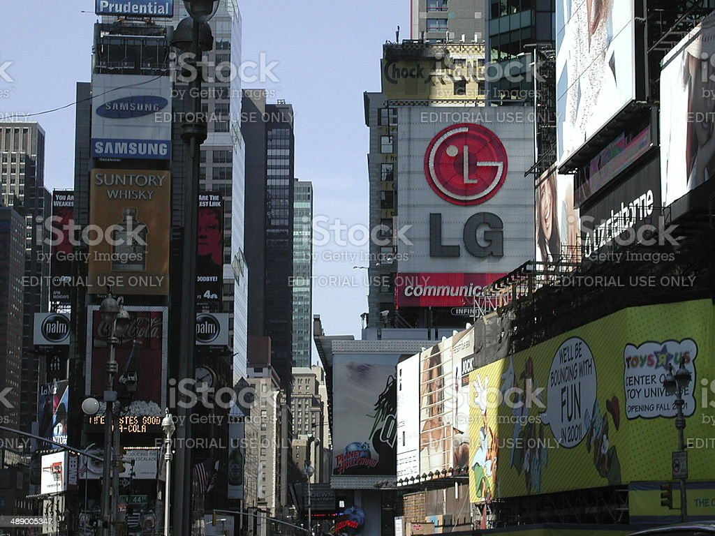 Billboards in Times Square display advertisements of many different...
