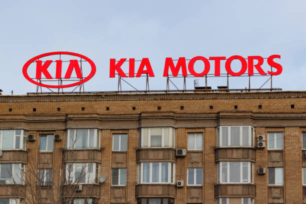 Billboard with logo of korean car manufacturer KIA Motors on the building roof stock photo