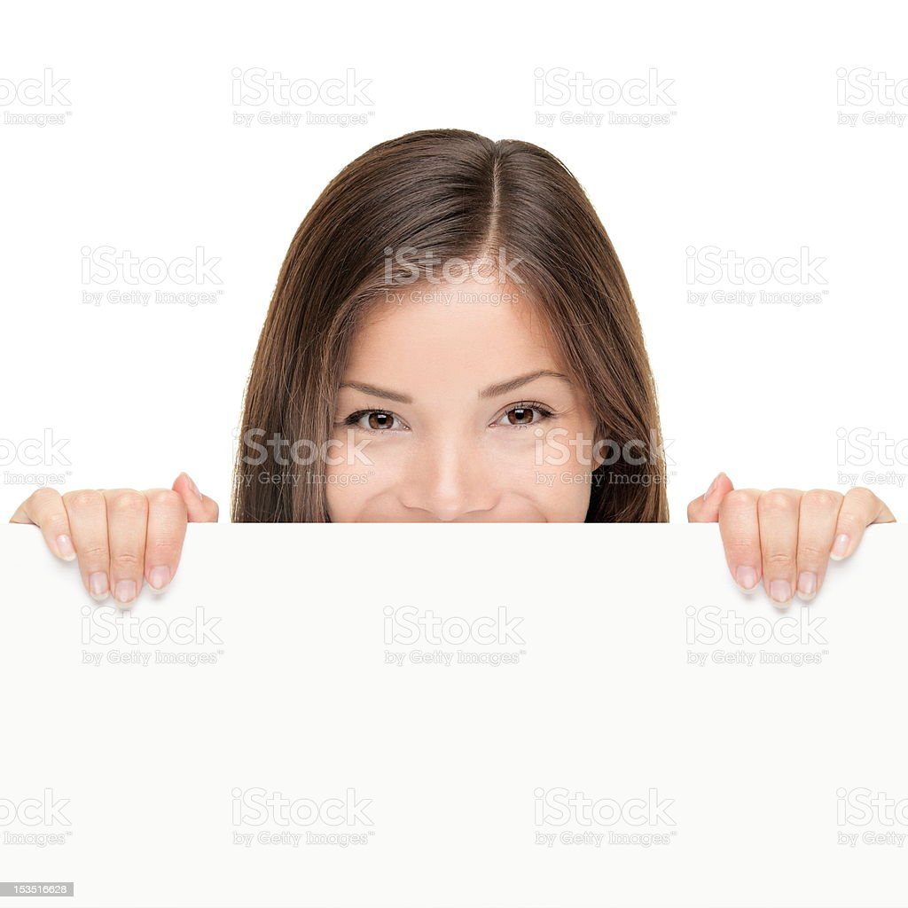 Billboard woman looking over sign stock photo
