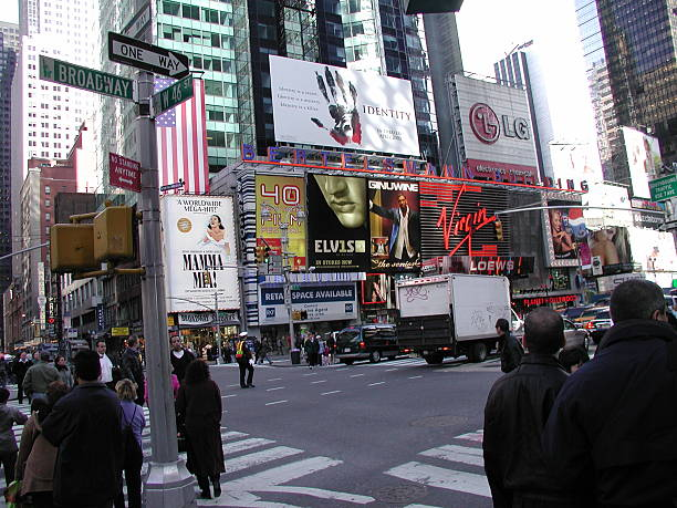 billboards at broadway intersection in times square - mamma mia stock photos and pictures