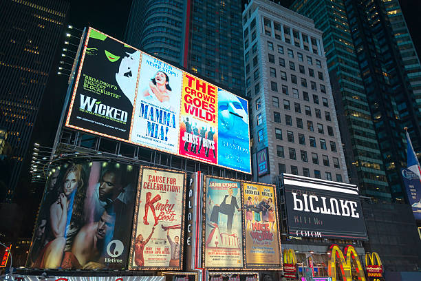 billboards at times square manhattan - mamma mia stock photos and pictures