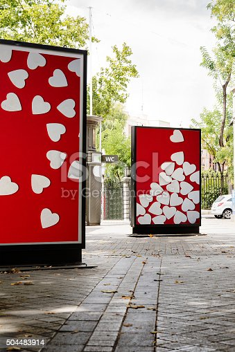 507397624 istock photo billboards with heart photographs at city street 504483914