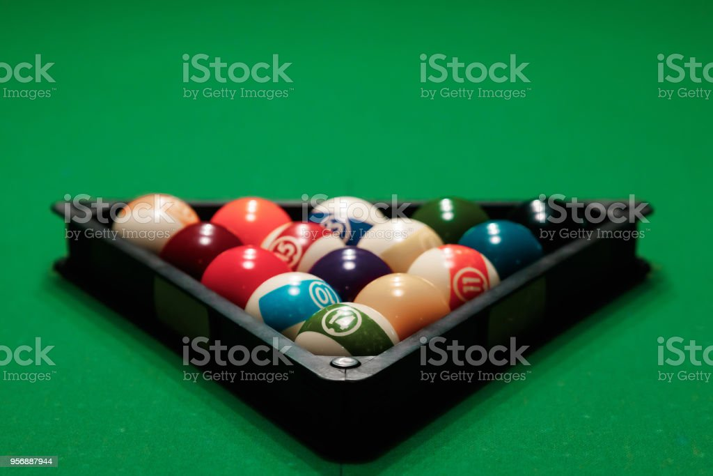 Billiard ball in the triangle on the billiard table, American billiards. Sports games, outdoor activities. stock photo