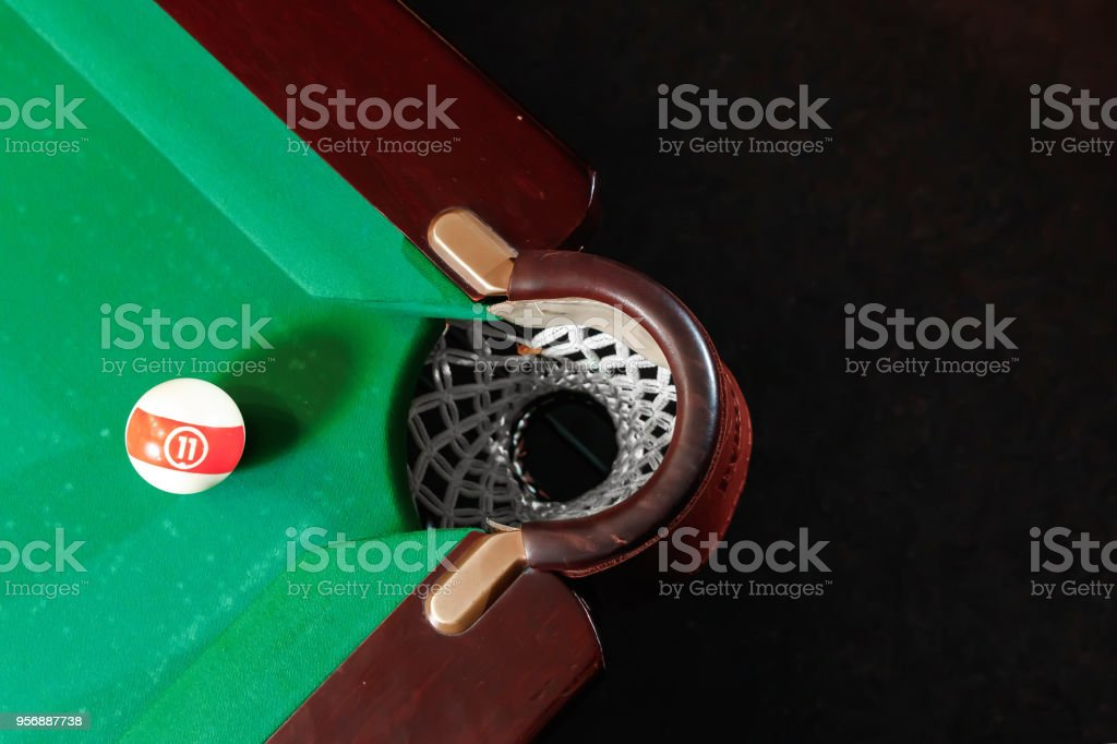 Billiard ball near the pockets on the billiard table, top view, American billiards. Sports games, outdoor activities. stock photo