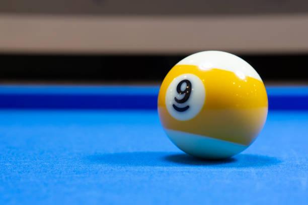 Billiard ball number 9 stock photo
