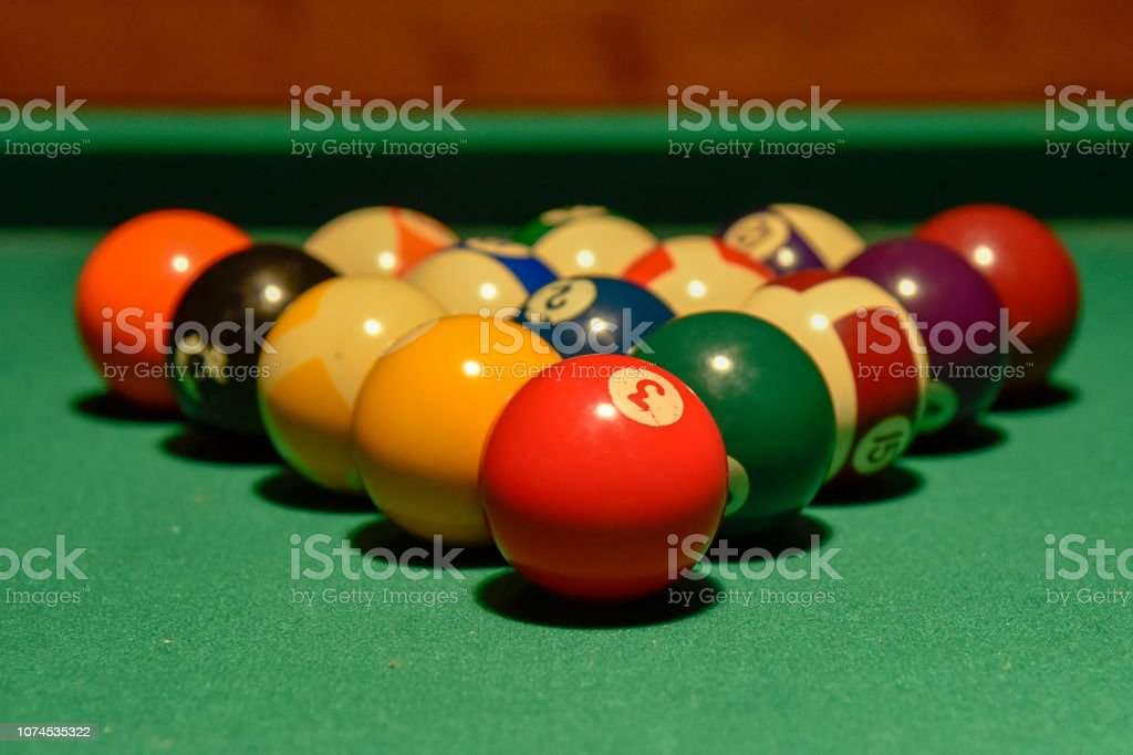 Billiard balls and cue on the pool table games, felt, numbers