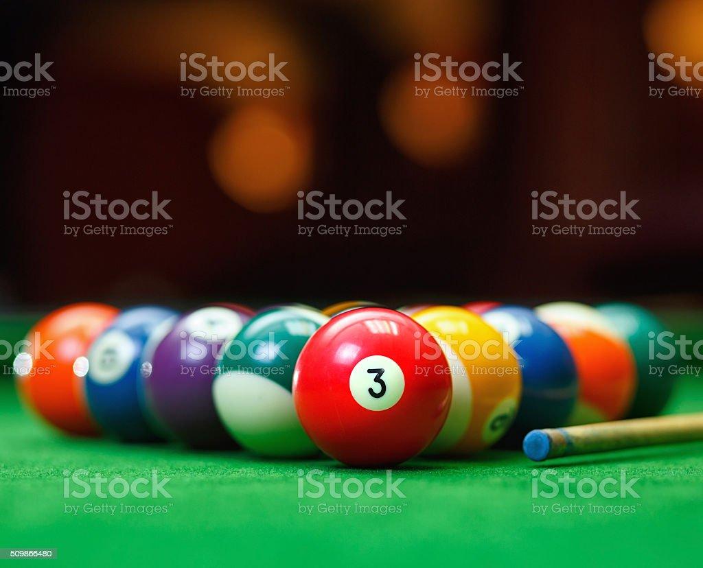 Billiard balls in a green pool table stock photo