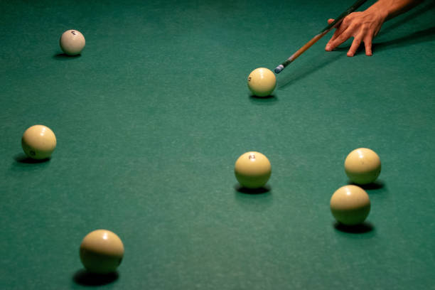 billiard balls on a green pool table. - cue ball stock pictures, royalty-free photos & images
