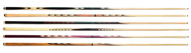 billiard cue sticks on white background - pool cue stock photos and pictures
