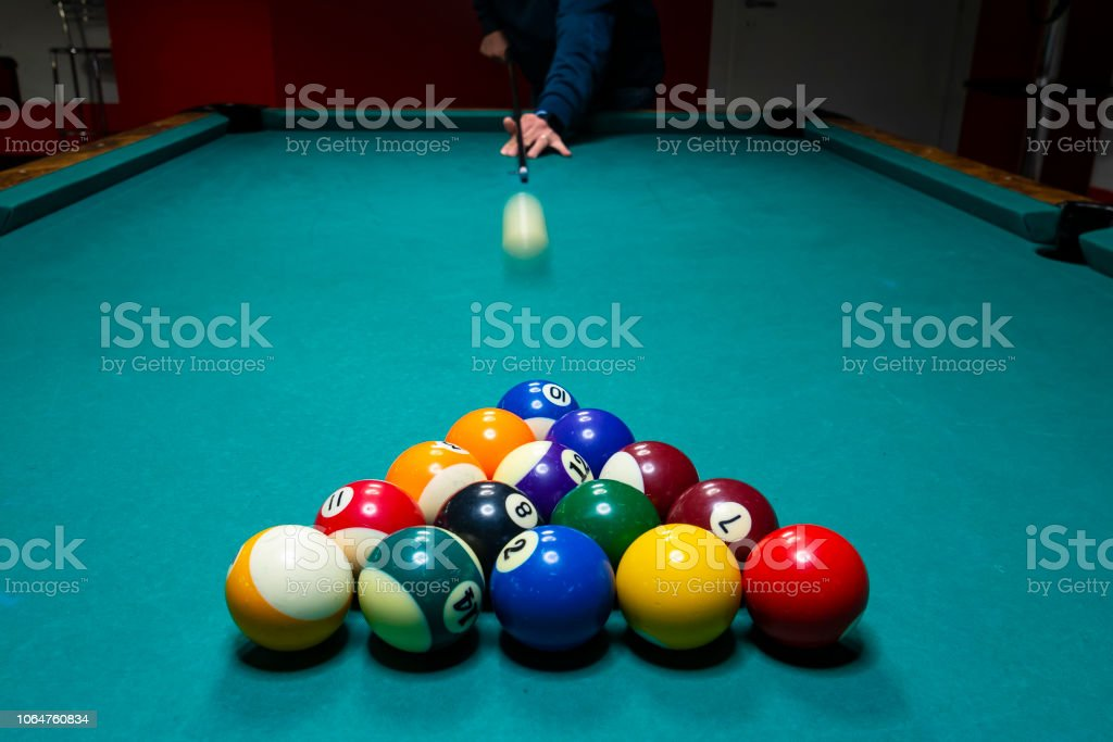 picture of a billiard table and balls
