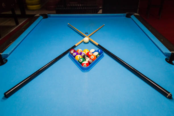 billiard pool balls in triangle and sticks on table - cue ball stock pictures, royalty-free photos & images