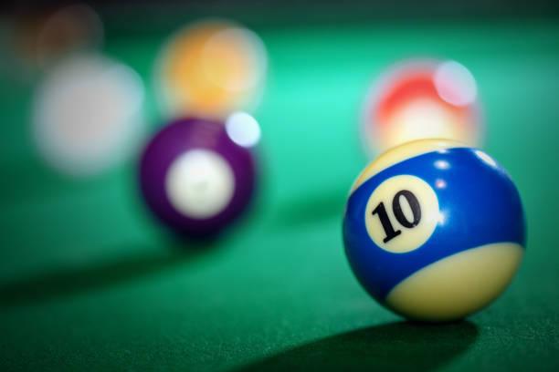 Billiard table and balls stock photo