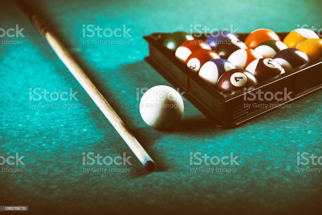 Billiards balls and cue on pool billiard table. Billiard sport...