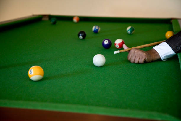 billiards player striking the ball - cue ball stock pictures, royalty-free photos & images