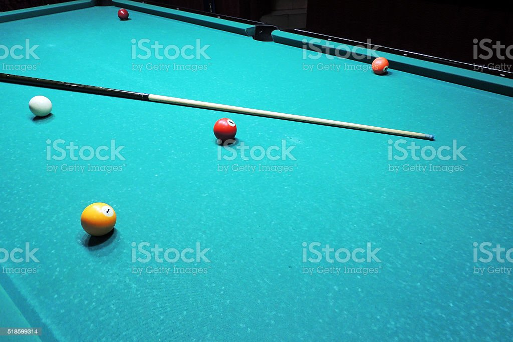 Billiards table and balls stock photo