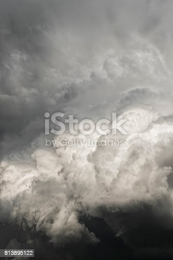 White billowing Cumulus clouds into dark gray Cumulonimbus storm clouds as a thunder storm rolls into the area during mid Summer.