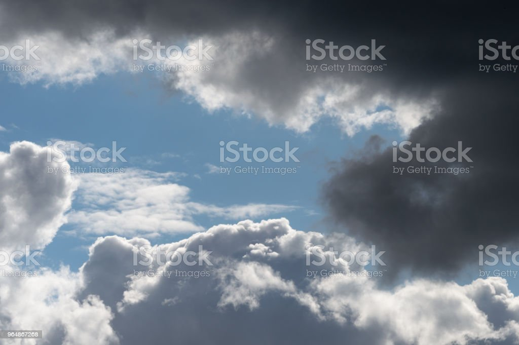 Billowing grey white clouds with blue sky. Stormy weather. royalty-free stock photo