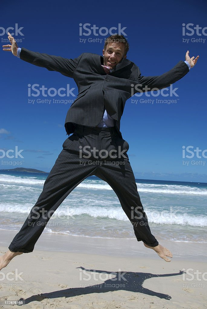 Billowing Suit Beach Jump royalty-free stock photo