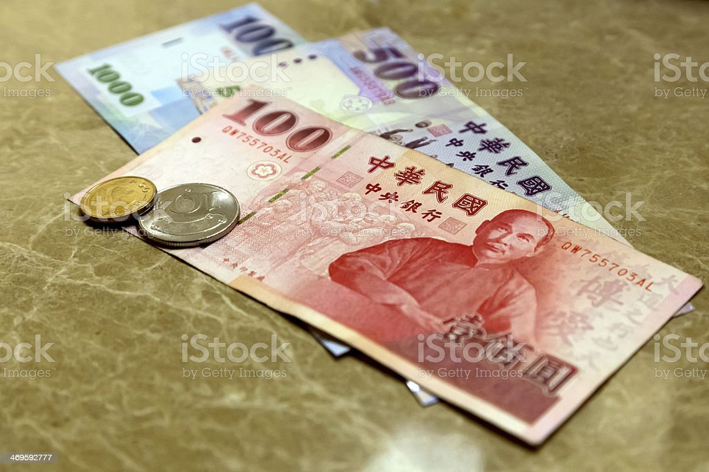Bills and coins in Taiwan stock photo